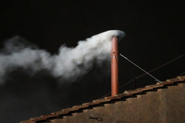 VATICAN CITY, VATICAN - MARCH 13: White smoke is seen from the roof of the Sistine